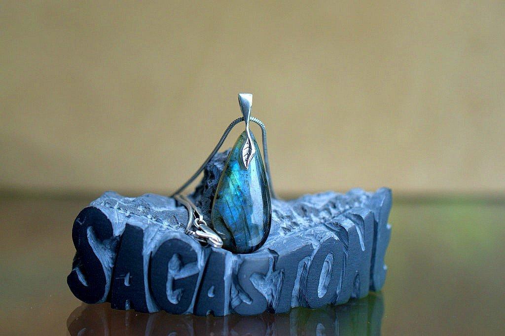 shimmering blue hue gemstone with leaf style bail