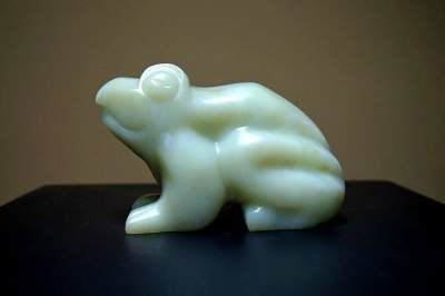 sitting frog light green stone sculpture