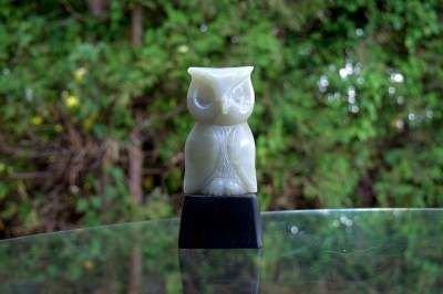 light green stone owl abstract figurine