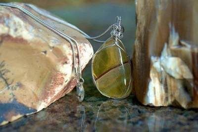 transparent yellow mineral pendant and