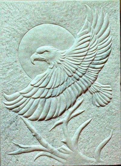 large white marble stone carving with flying eagle