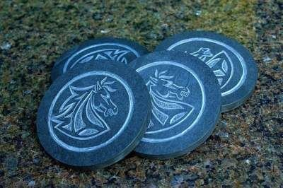 four black disk shape stone with carved horses