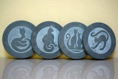 four differently positioned cats on carved stone