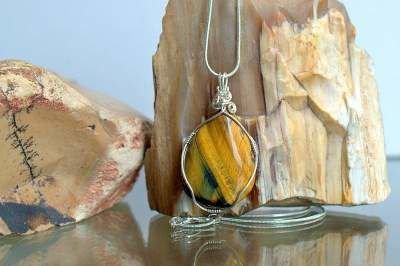 vibrant gold and brown silver set stone pendant