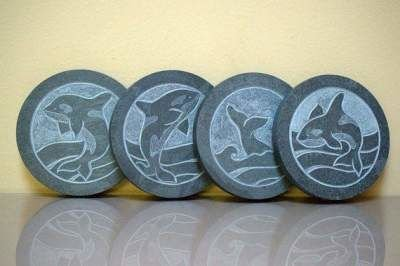 whale carving on black round shape stones