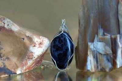 purple base color gemstone with black spots