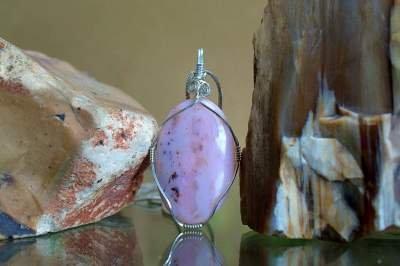 pink oval shape silver set stone necklace