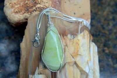 light green silver set mineral pendant
