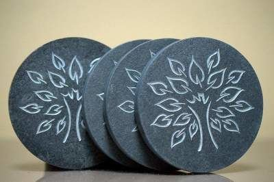 tree design carving on black round stones