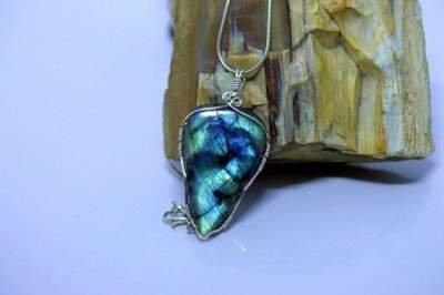 vibrant blue and gold triangle shape gemstone