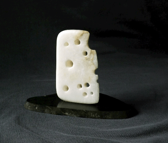 Alabaster cheese figurine on green Slate base