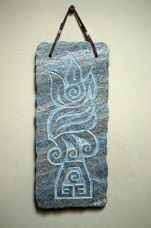 hand carved stone wall panel