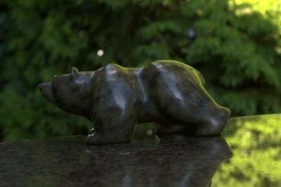 Dark green bear stone carving