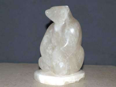 Alabaster sitting Polar bear
