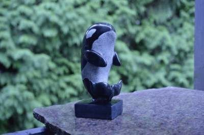 Black stone killer whale carving