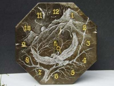 Marble clock with eagle carving