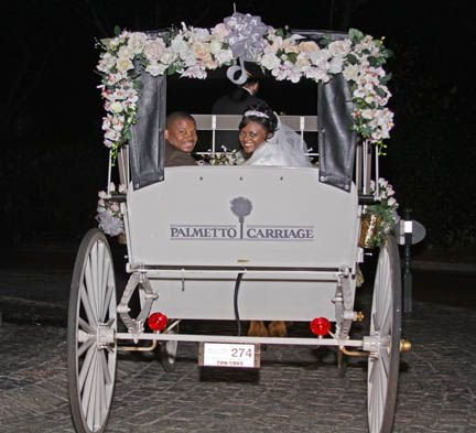 Bride and groom in Charleston horse and carriage