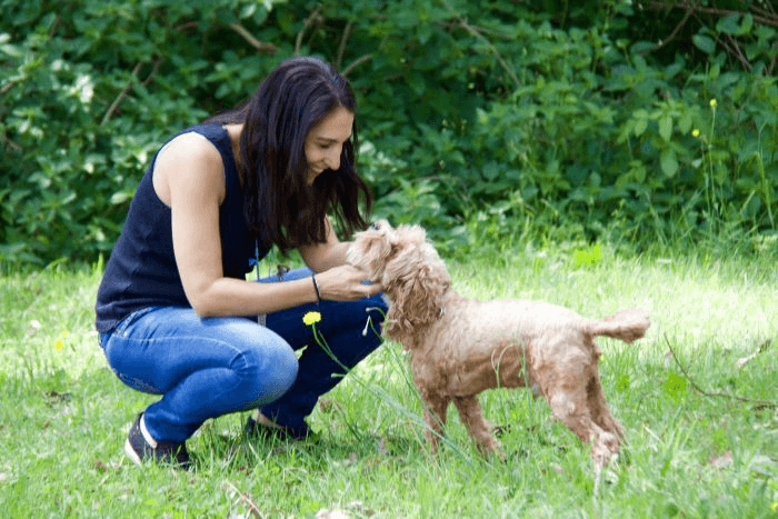 Ms Zorbalas playing with her dog Tiger