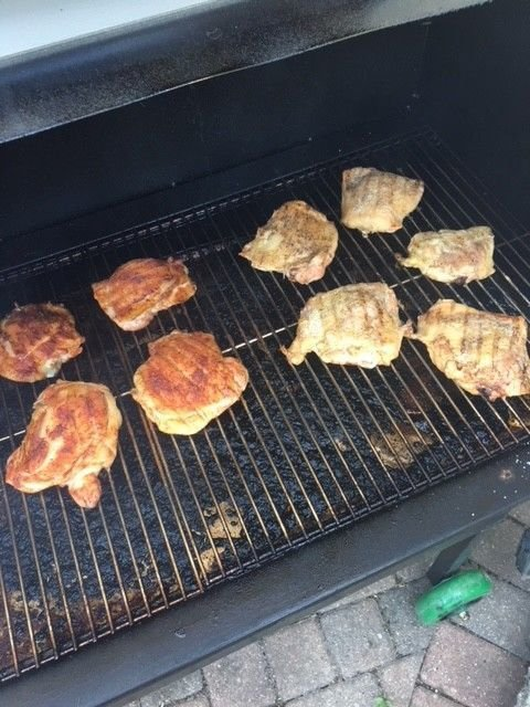 Grilling chicken thighs on the grill