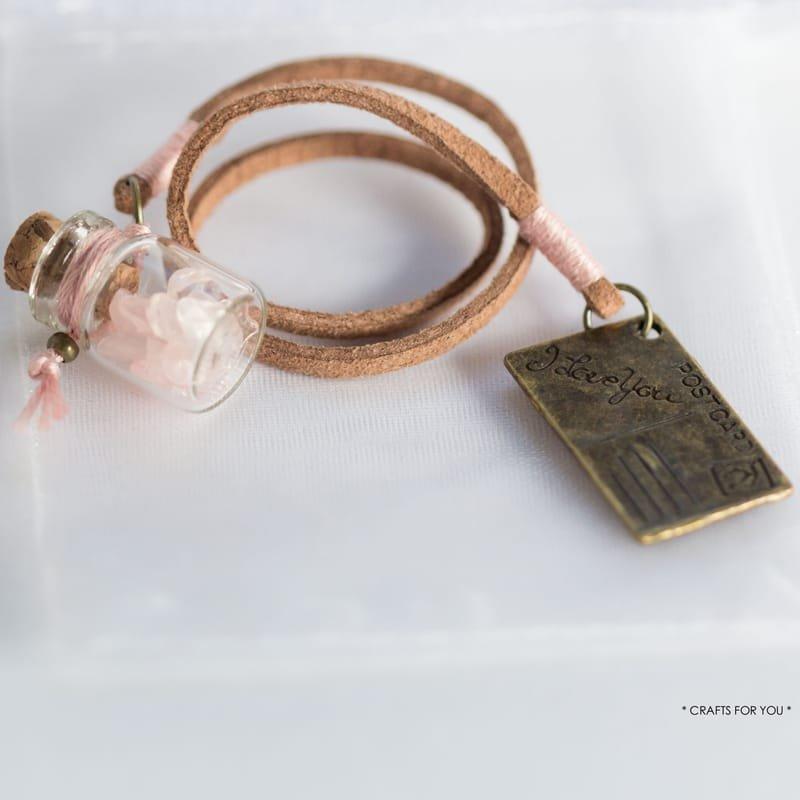 Mini-bottle with rose quartz chips & postcard