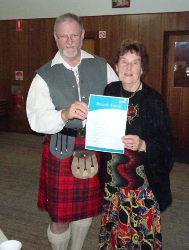 Jean Lumsden receiving her award from the President