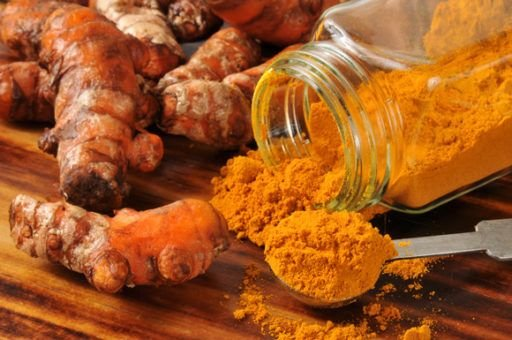 turmeric-roots-and-a-jar-of-turmeric-powder