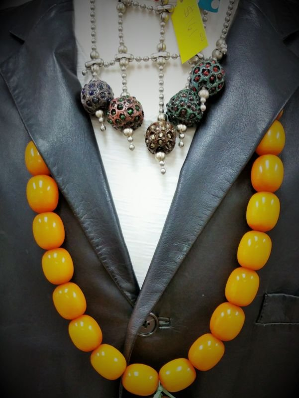 Vintage Amber with apple seeds plus Scott take organic seeds and makes them into a neck piece.