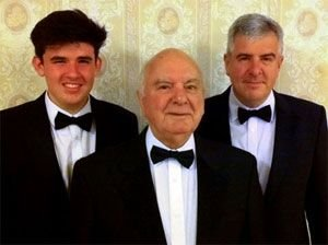 Gordon Williams – 69 years a member of Rhos Male Voice Choir – with son Kevin and grandson Gruffydd.