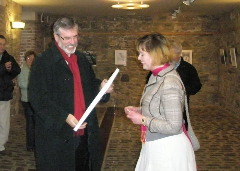 At the opening of 'Act of Enclosure' in the Phoenix Park Visitor Centre, 2010, Gerry Adams MLA accepts a framed drawing from the Artist